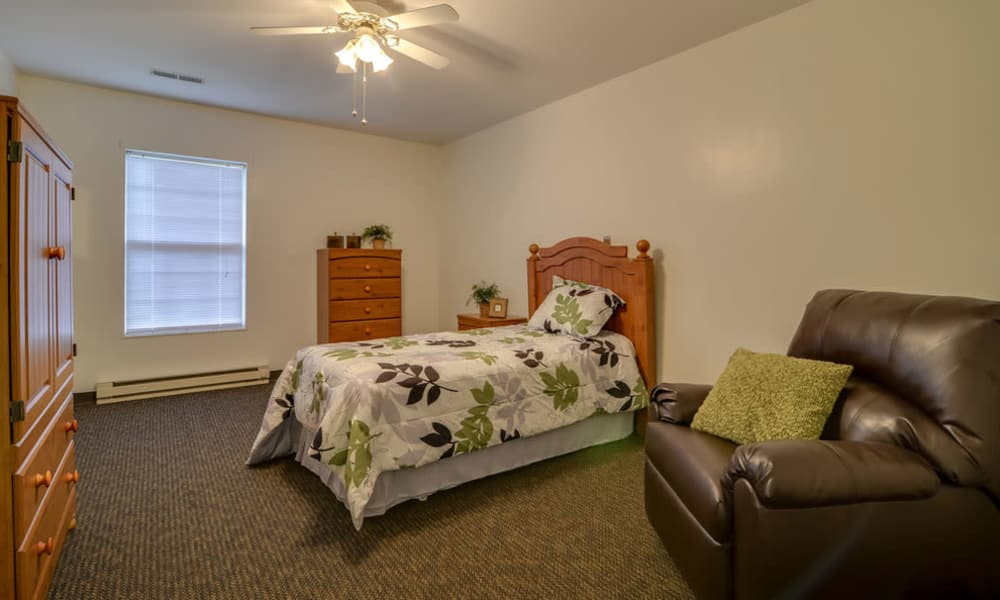 Large bedroom for assisted living residents at Ashbrook in Farmington, Missouri