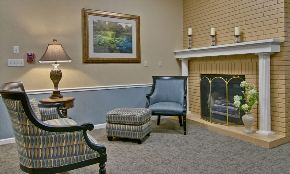 Cozy seating by a fireplace for assisted living residents at Parkside Senior Living in Rolla, Missouri