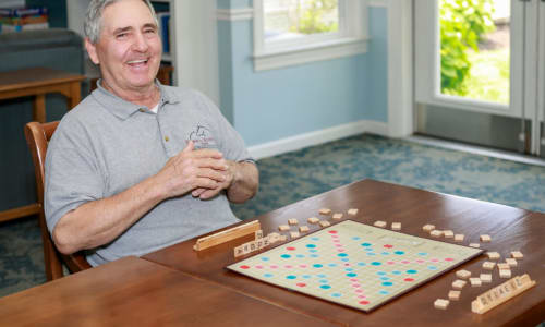 Resident playing scrabble at Traditions of Lansdale in Lansdale, Pennsylvania
