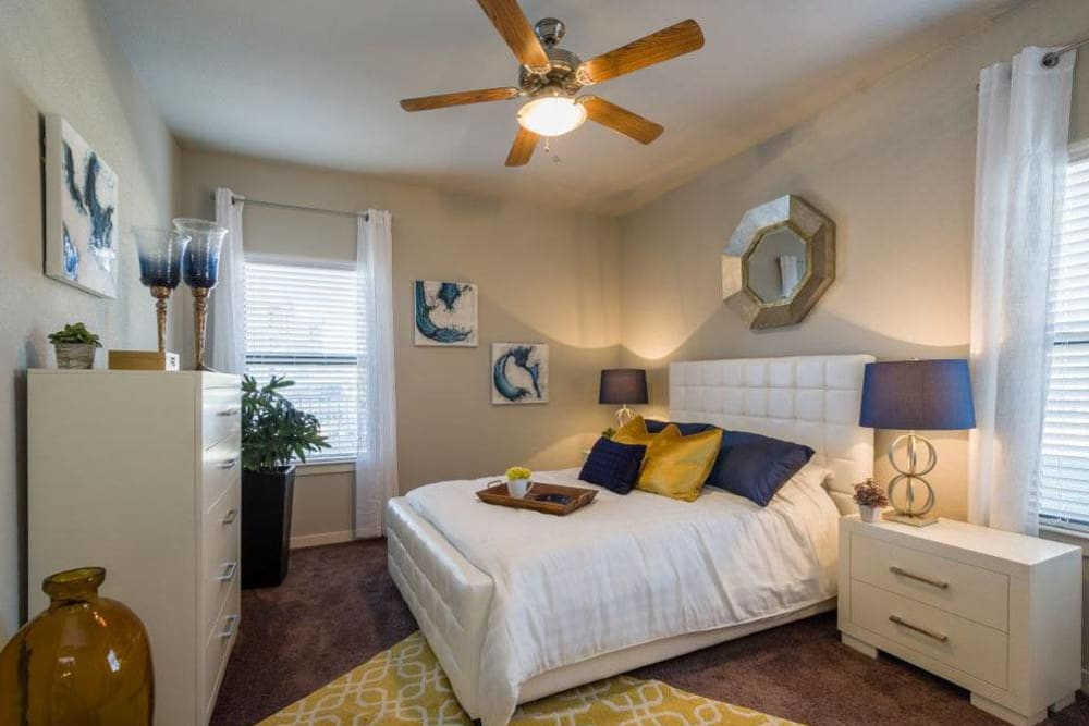 Nice decorated bedroom with ceiling fan ready for move in at Verandas at Alamo Ranch in San Antonio, Texas