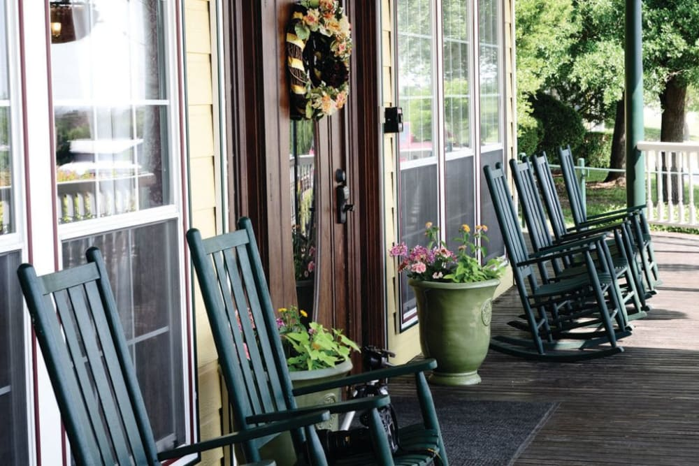 Chairs on the front porch at Quail Park of Granbury in Granbury, Texas