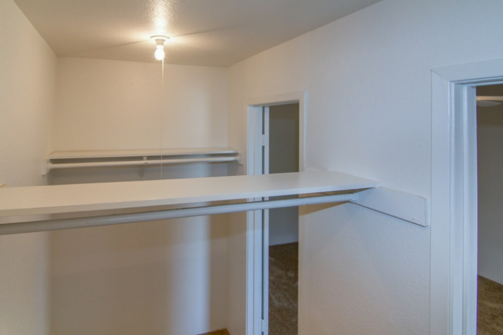 Walk-in closets at apartments at Meadow Park Apartments in Alvin, Texas