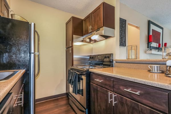 Well-lit kitchen at City Center Station Apartments in Aurora,