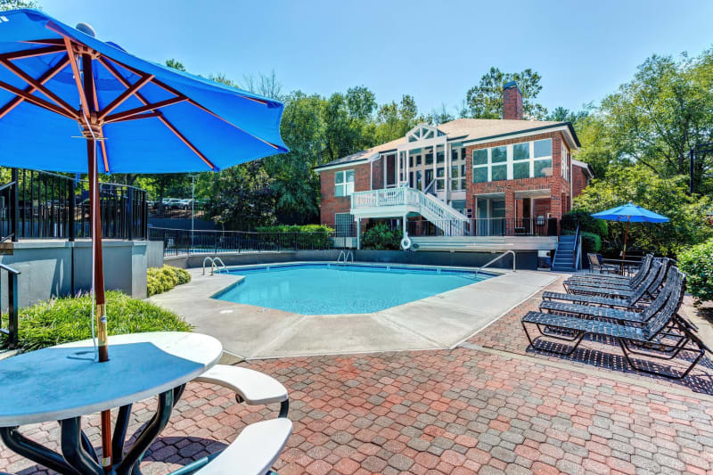 Shaded seating and chaise lounge chairs near the swimming pool at Lyric on Bell in Antioch, Tennessee