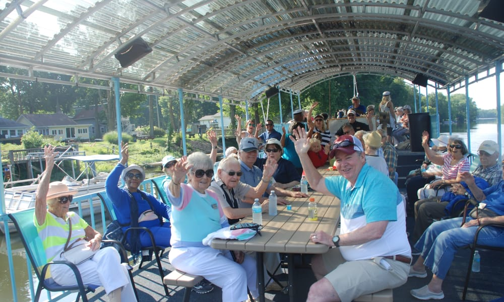Residents enjoying a boat ride together near Ashwood Meadows Gracious Retirement Living in Johns Creek, Georgia