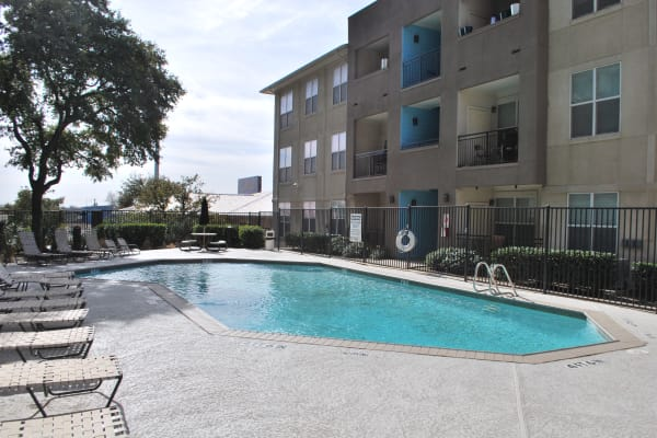 Resort-style swimming pool at Providence Mockingbird Towers in Dallas, Texas