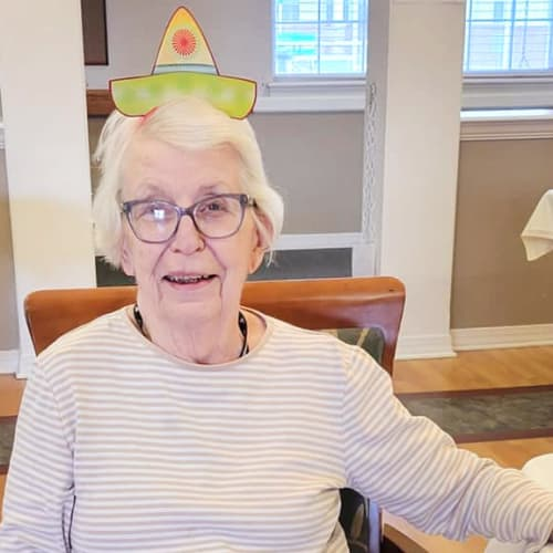 A resident with a fun hat at Homestead House in Beatrice, Nebraska