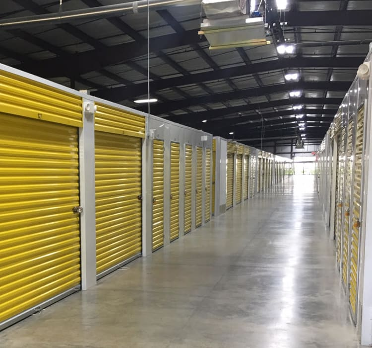 Bright and clean interior storage unit hallway at Storage Star Red Bluff in Pasadena, Texas