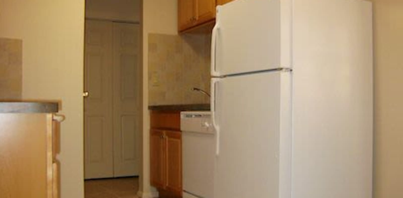 Fridge and dishwasher at Pine Crest Apartments in Milford, New Jersey