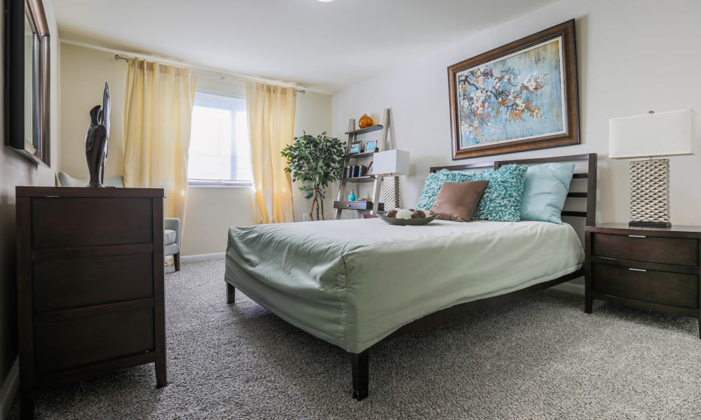 Master bedroom with room for a desk and a large bed at Regency Pointe in Forestville, Maryland