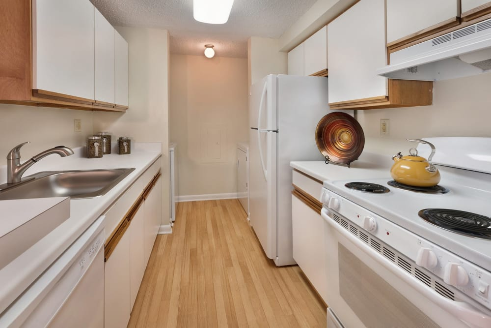 Kingscrest Apartments kitchen with white appliances in Frederick, Maryland