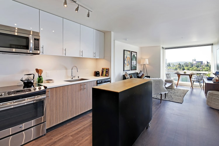 Kitchen with stainless-steel appliances at Rooster Apartments in Seattle, Washington