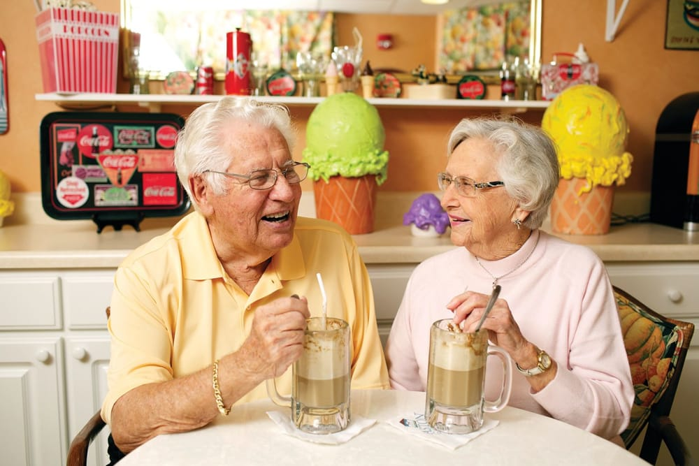 elderly couple enjoying shakes in Bonita Springs