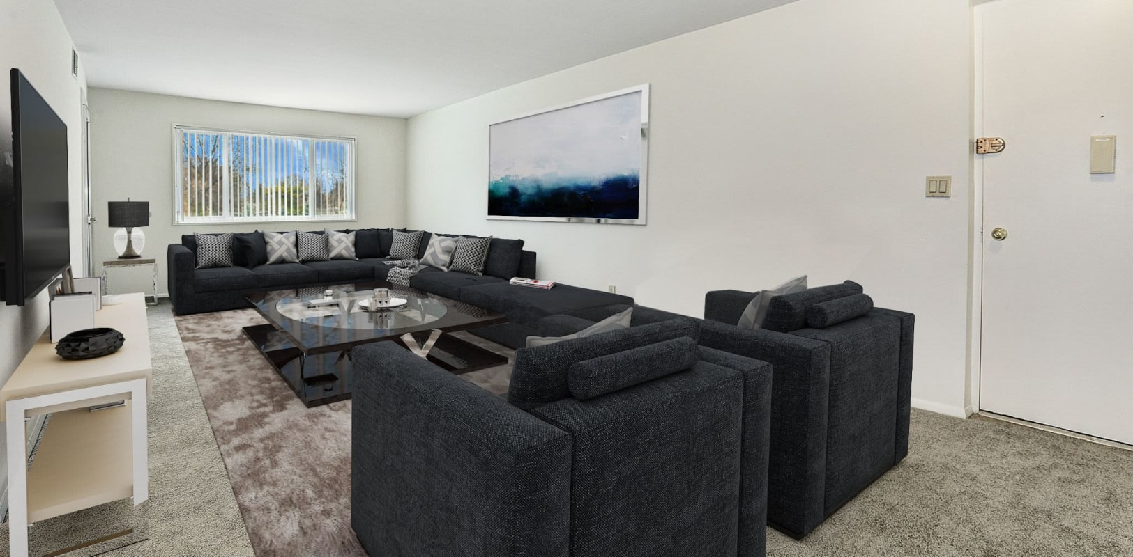 Furnished living room with large tv wall mounted at Penn Crest Apartments in Allentown, Pennsylvania