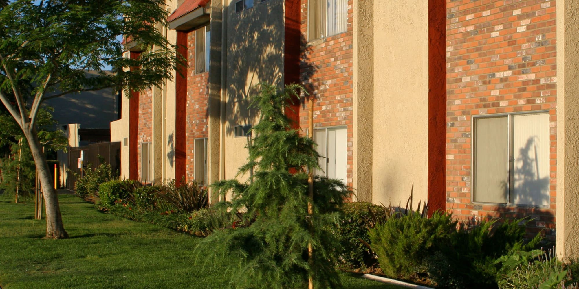 Professionally manicured landscaping outside resident buildings at Parkwood in Lancaster, California