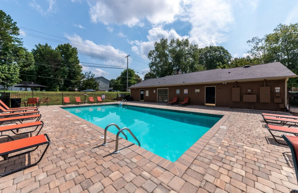 Swimming pool with a large sundeck at Waters Edge Apartment Homes in Concord, North Carolina