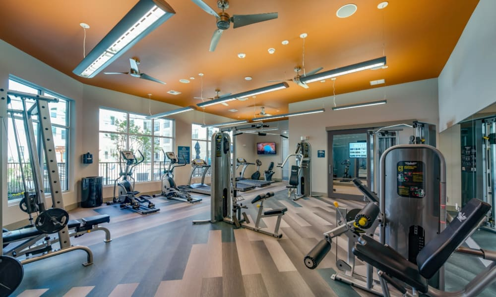 Full fitness center with everything to get a good workout in at Bellrock Upper North in Haltom City, Texas