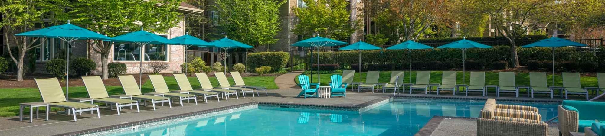 Schedule a Tour at The Grove at Orenco Station to enjoy our outdoor pool, in Hillsboro, Oregon