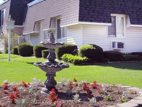 Lush landscaping at Newcastle Apartments in Rochester, New York