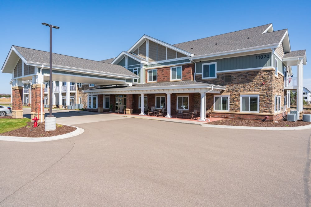 Front entrance of building with car port at Arbor Glen Senior Living in Lake Elmo, Minnesota