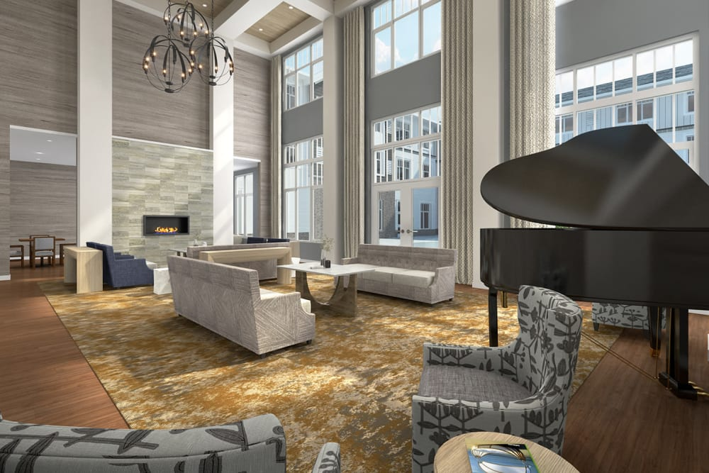 Community room with a piano and fireplace at Anthology of Novi - OPENING 2020 in Novi, Michigan
