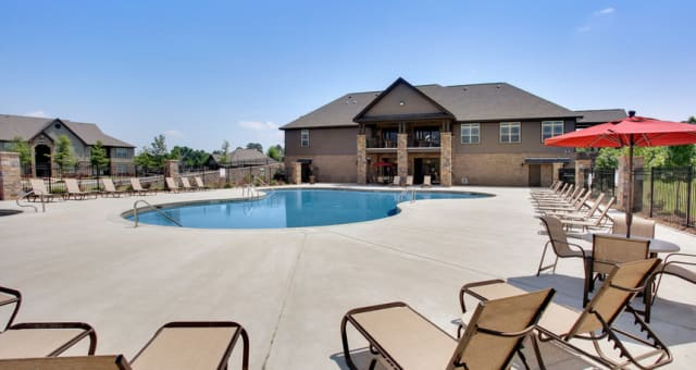 Poolside lounge chairs are nice for tanning at The Grove at Stone Park in Pike Road, Alabama
