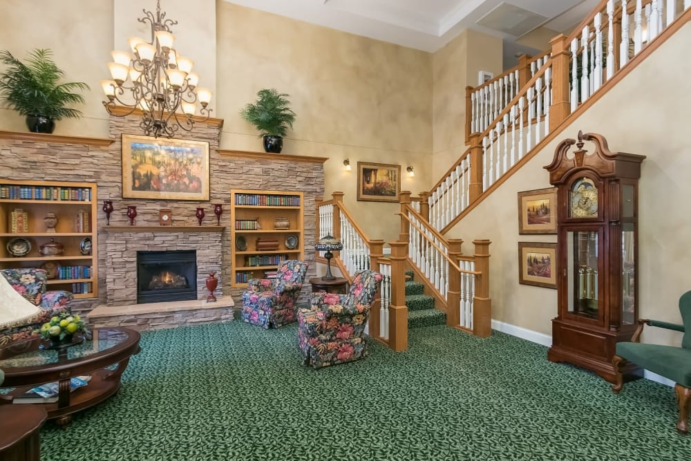 Fireplace and great stairway at Applewood Pointe Woodbury in Woodbury, Minnesota.