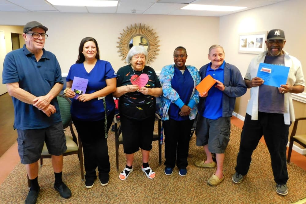 Residents and staff members posing for a picture at Bradenton Oaks in Bradenton, Florida