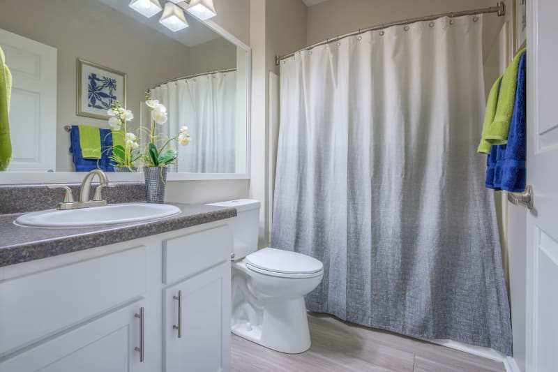 Bathroom and shower with large mirror at The Mark in Raleigh, North Carolina