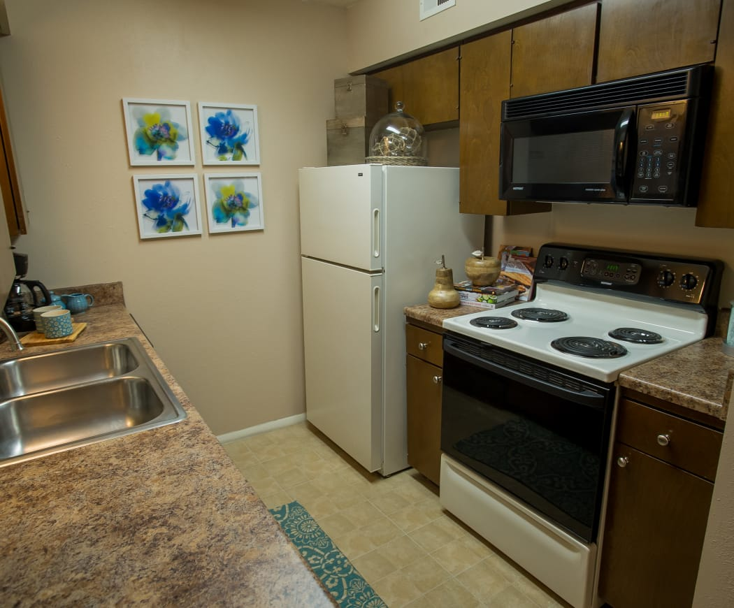Kitchen with granite-style countertops at Barcelona Apartments in Tulsa, Oklahoma