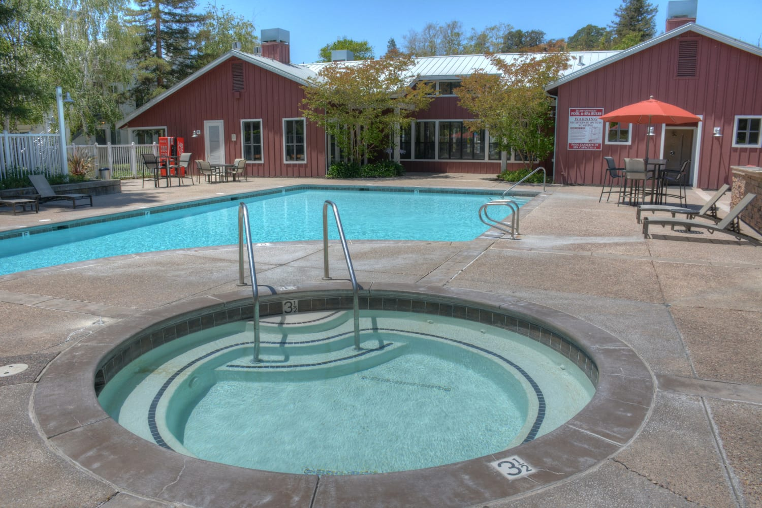 Enjoy access to a hot tub and a swimming pool at Cotton Wood Apartments in Dublin, California
