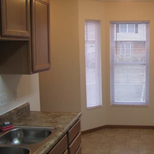 Kitchen and dining area with bay windows at Indian Footprints Apartments in Harrison, Ohio