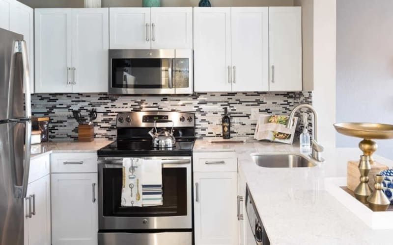 Bright kitchen at Alesio Urban Center in Irving, Texas