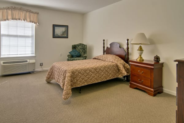 Assisted living apartment bedroom at Westport Estates Senior Living in Marshall, Missouri