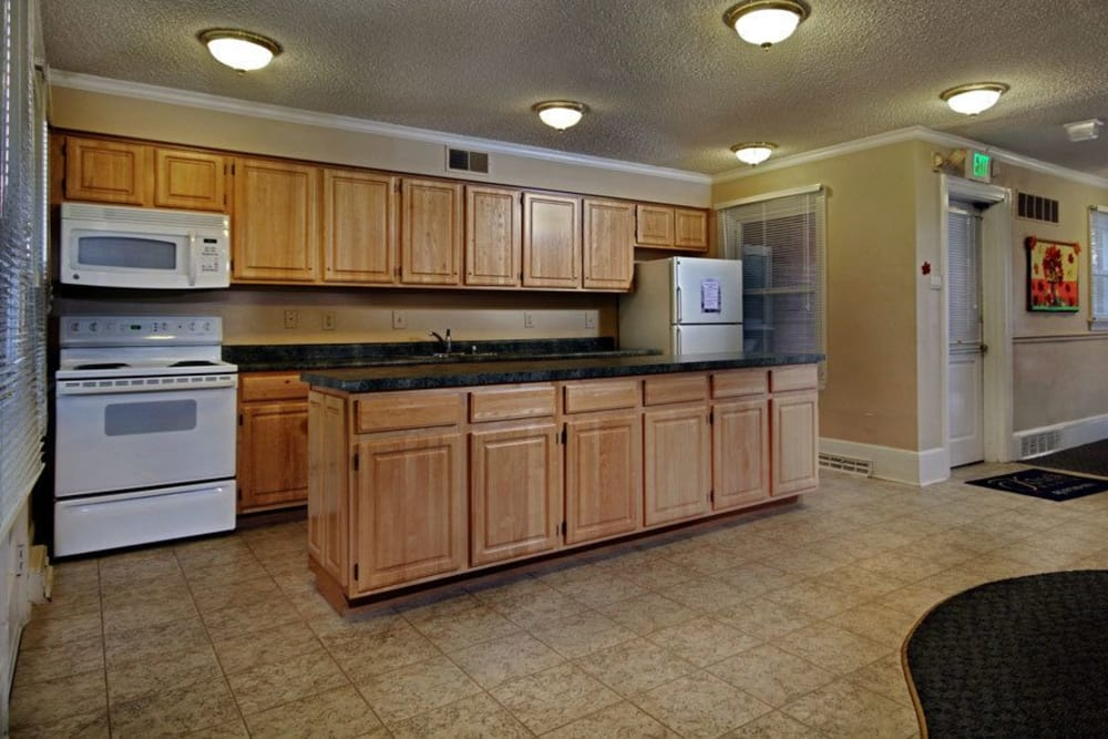 Bright kitchen with tile flooring at King's Manor Apartments in Harrisburg, Pennsylvania
