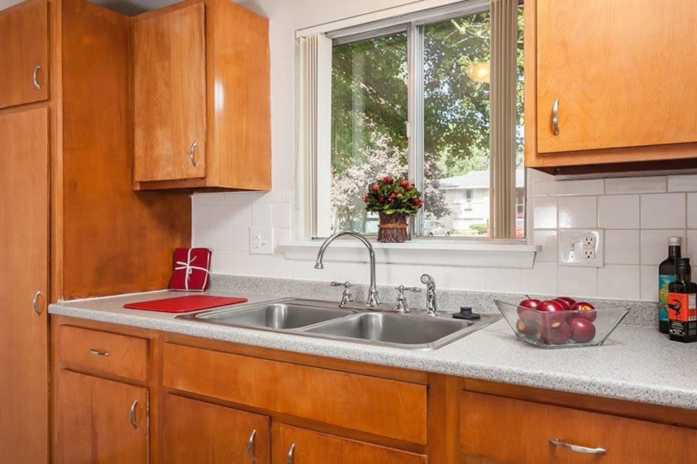 Kitchen sink at Long Pond Gardens Senior Apartments in Rochester, New York