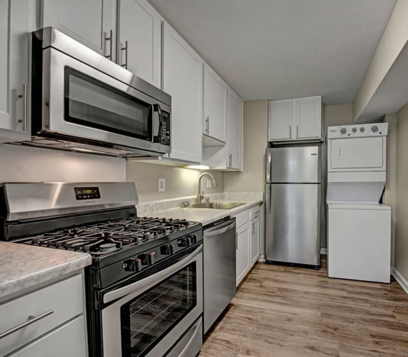 Fully equipped kitchen with wood style flooring at Howard Crossing in Ellicott City, Maryland