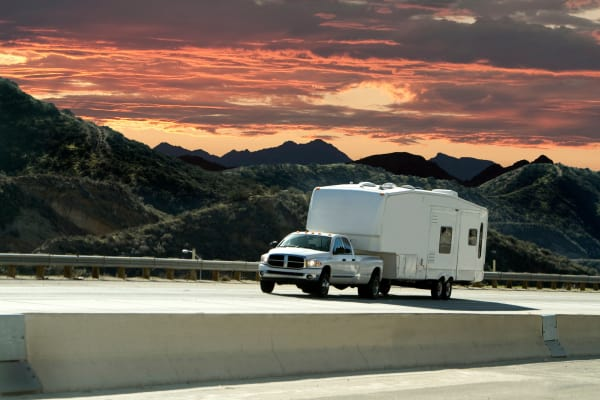 Truck pulling a camper on a highway near A Better Self Storage Bott in Colorado Springs CO