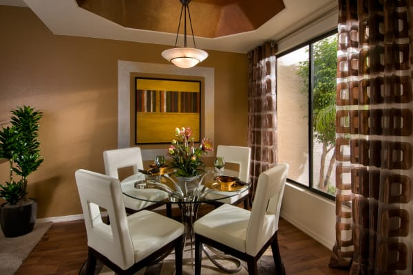 Modern decor in dining and breakfast bar area of model home at San Palmilla in Tempe, Arizona