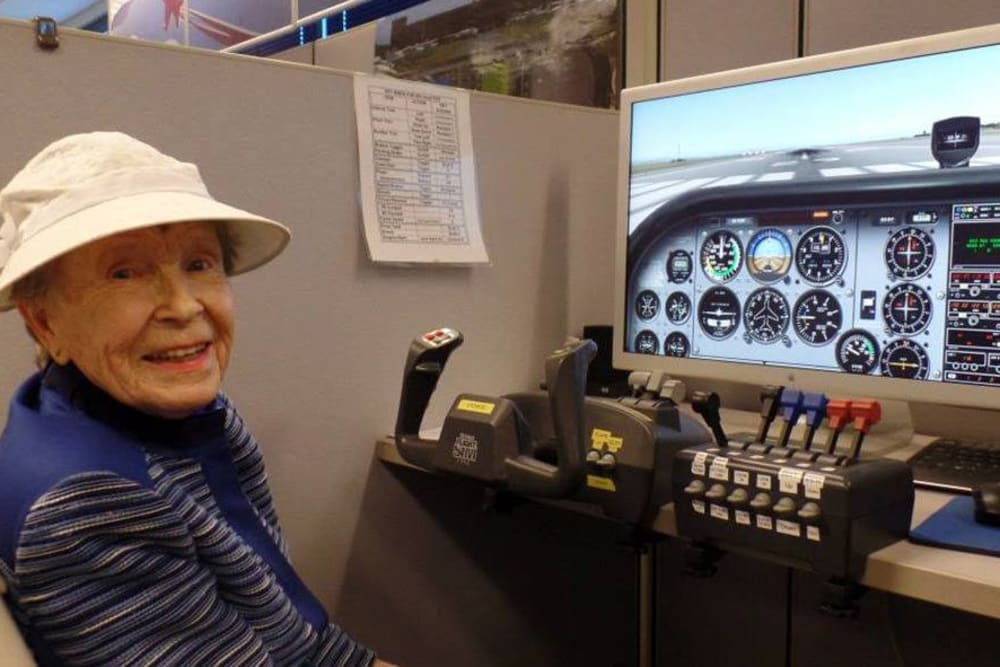Playig on a flight simulator at Roseville Commons Senior Living in Roseville, California