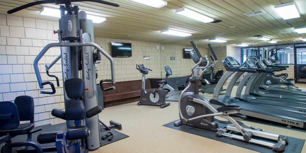 Fully equipped fitness center at Sunchase Apartments in Tulsa, Oklahoma