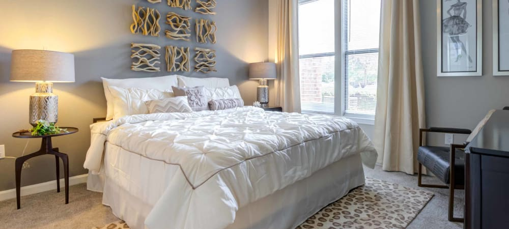 Nice well lit bedroom in a decorate model home at Celsius in Charlotte, North Carolina