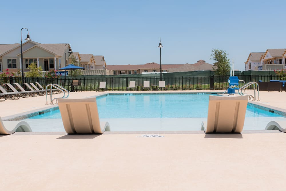 Poolside patio view at Springs at Sunfield