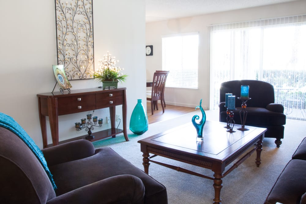 Living room with a patio at Valley West Apartments in San Jose, California