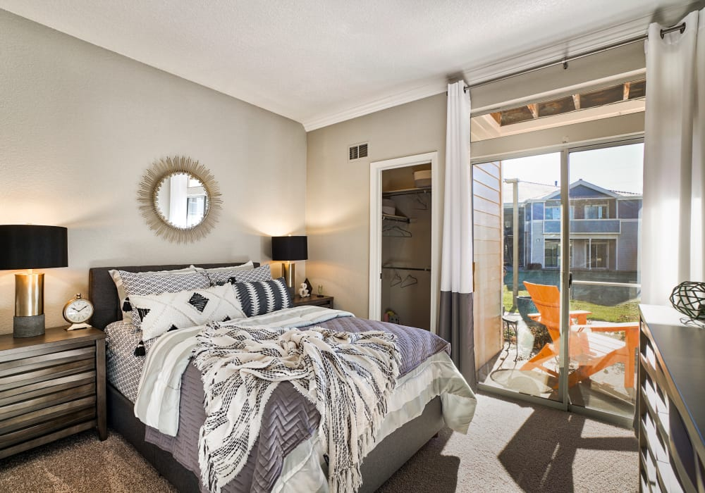 Bedroom with view to personal patio at The Pavilions at Silver Sage