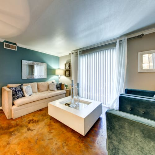 Bright and open living room with access to private balcony at Austin Midtown in Austin, Texas