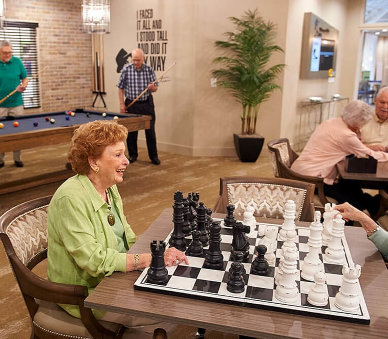 Resident playing chess at Celebration Village in Acworth, Georgia