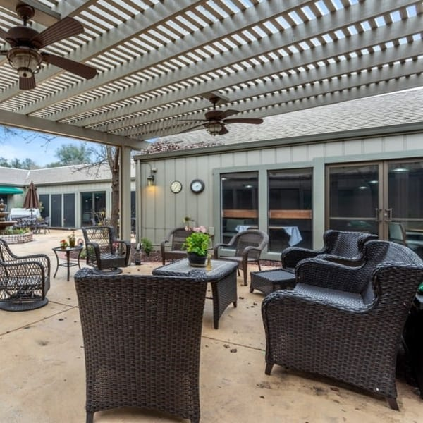 Covered patio seating at The Crest at Citrus Heights in Citrus Heights, California