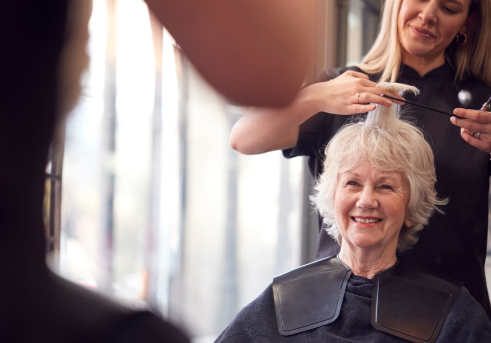Resident getting a haircut at Holden Southcenter in Tukwila, Washington.
