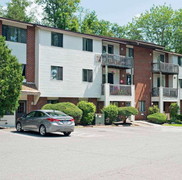 Mill Creek Apartments offers a parking area in East Greenbush, NY